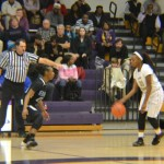 LEADING THE TEAM -- Sandrea Sylman, one of the key leaders for the Lady Pounders basketball team, dribbles down the court.