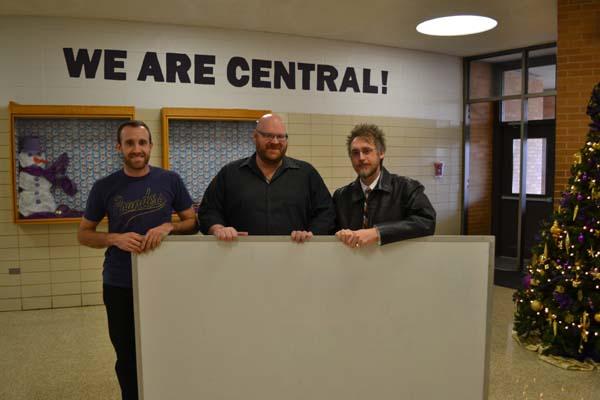 A FEW GOOD MEN -- (from left) Mr. Luke Robinson, Rob Alderman, & Eric Wilbanks holding the donated whiteboard