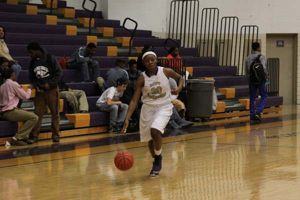 GIRLS BASKETBALL -- Sandrea Sylman dribbling up the court against Hixson. She had 15 points.