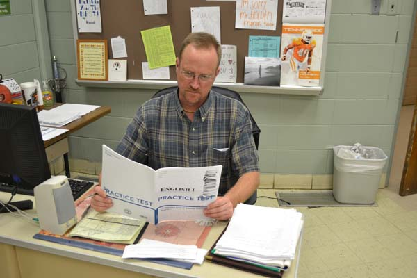 HOLDIN' ON -- English 9 teacher Mr. Mark Holden reviews EOC practice tests prior to his fifth-block class.