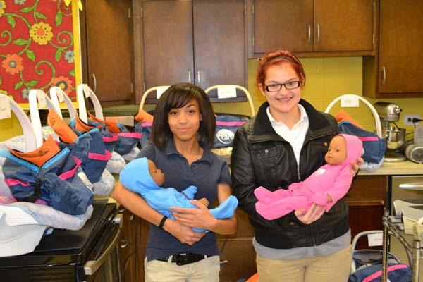 MILLION DOLLAR BABIES -- Starlar Williams and Jessica Chattin holding their 'babies' in Child Development