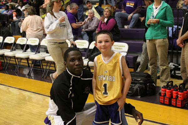 A STORM IS COMING -- David ' Hurricane' Holley with future NBA star Jacob Mroz
