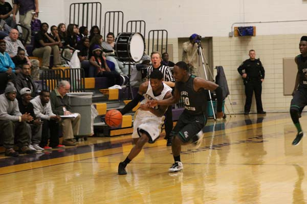 BOYS BASKETBALL -- #10 Robert Cobb dribbles up the court against tight press defense