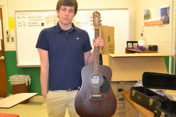 STRUMMIN' CHORDS -- Michael Smith getting ready to play in guitar class
