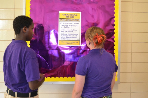 ANTI BULLYING POSTERS -- Freshmen Kiki Evers (left) and Alyssa Rosenzweig look at the new anti-bullying posters.