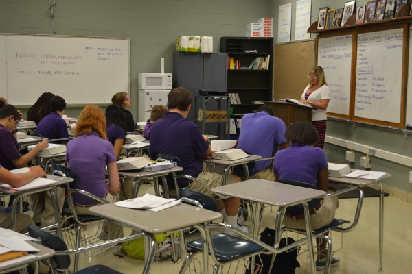 GRAPE JUICE -- Members of Mrs. LeeAnn McBryar's English 9 class listen to her lecture during fourth block.