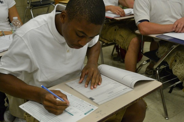 TEST SCORES -- Jayson Jones taking his English exam
