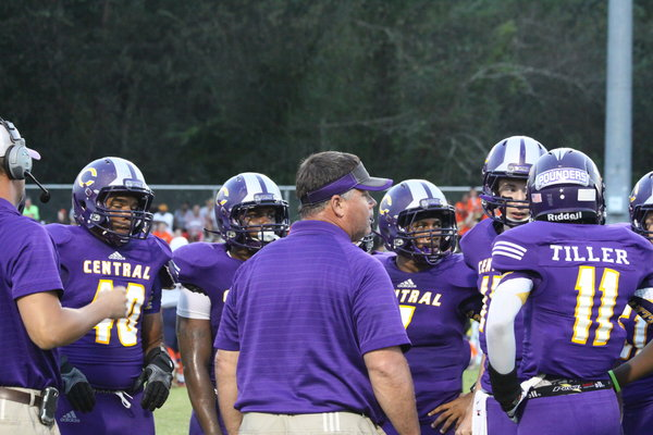 TIME FOR A CHAT -- Pounders Coach John Allen (center) discusses the team's performance during a time out of the East Ridge game. Central upset Marion County 21-19, Friday, Sept. 13, in Jasper.