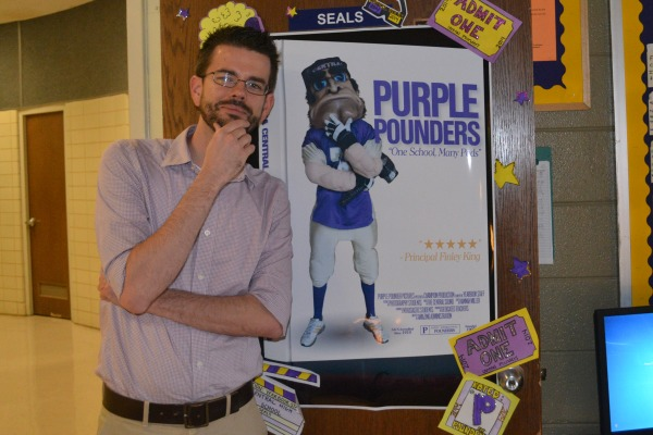 NEW YEARBOOK COVER REVEALED -- Mr. Seals stands to the new cover of Stan the Pounder-Man
