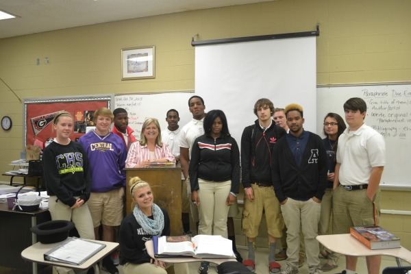 TEACHER OF THE WEEK -- Mrs. Moore and some of her favorite students