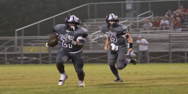 PURPLE PRIDE -- Central's Sean Montgomery (left) heads up the field as Scout Morgan follows. The Pounders handily defeated McMinn Central, 35-0.