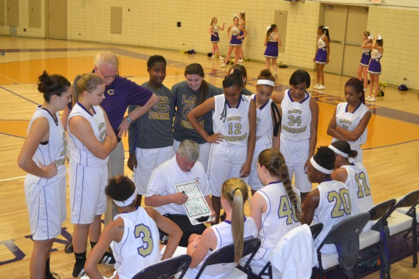 TEAM MEETING -- Coach Rick May talks to his team during a break in the game. File photo from 2013 season.