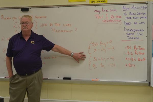 IT DOESN'T ADD UP -- Mr. Brock works a problem during Algebra II class.
