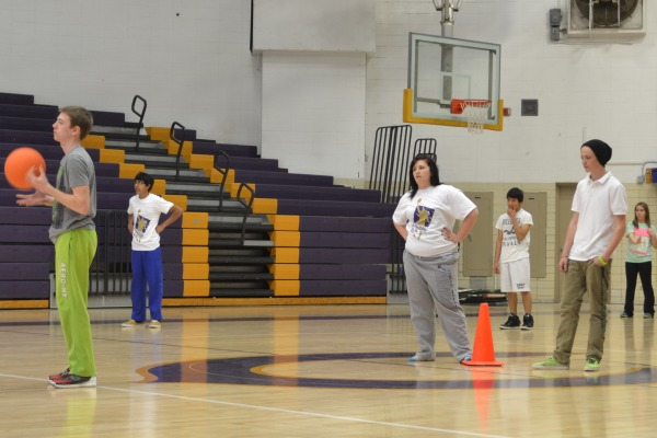 LACK OF ENTHUSIASM --Skylor Turner and Makenzi Logan play kickball in Wellness Class without much excitement.