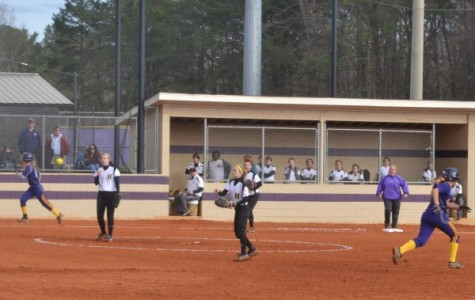 ROUNDING THIRD -- The softball season is just starting out and the Lady Pounders are extremely excited.