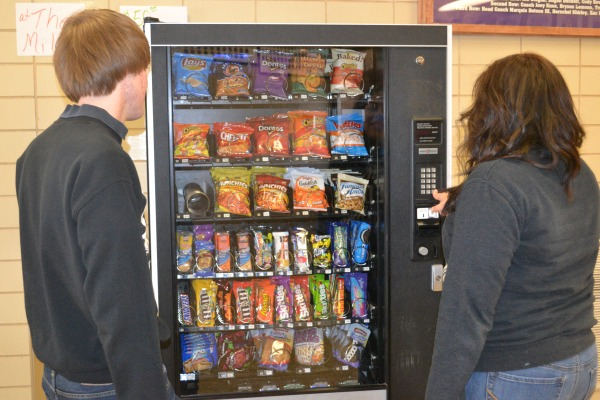 VENDING MACHINES GONE -- Cassandra Guevara and Jake Sizemore are upset that vending machines are not working anymore