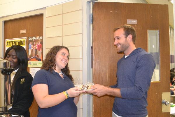 BOOM, BOOM!--Hali Smith and Endiya Rice serve Mr. Robinson his plate of goodies.