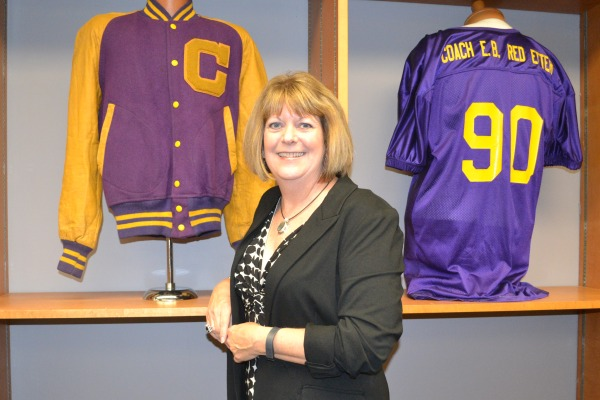 PURPLE POUNDER PRIDE -- Three decades after her graduation, Linda Hisey is still proud of her alma mater.