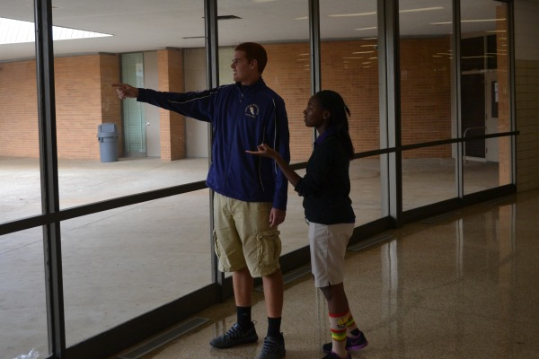 CALLED TO LEAD -- Brandon Lewis guides freshman Monet Henderson around the Central.