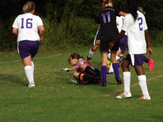 CENTRAL'S KEEPER DIVES FOR THE BALL--Madison Pitts, Rebecca Allen.