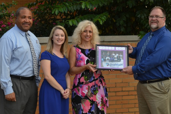 BRIELLE FARROW PICKED AS THE CLASS OF 2021 DEDICATORY -- (From left to right) Biology teaher Gary Fomby, instructional coach Brielle Farrow, OneMain Financial branch manager Betsy Corum, and Assistant Principal Steve Lewis celebrating a grant that was awarded to assist Farrow's chemistry classes. File photo from 2014.