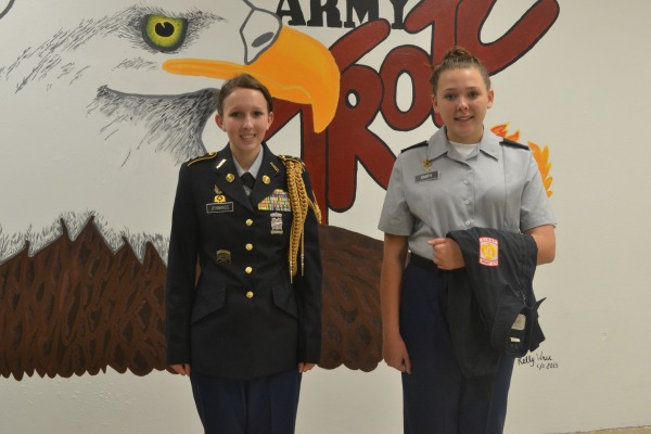 THE EXPERT AND THE BEGINNER -- Senior Casey Jennings and freshman Alissa Smith make up part of the rifle team.
