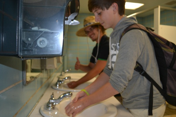 SCRUB A DUB -- Jake Whitaker and Matthew Cramer take the time to wash and dry their hands.