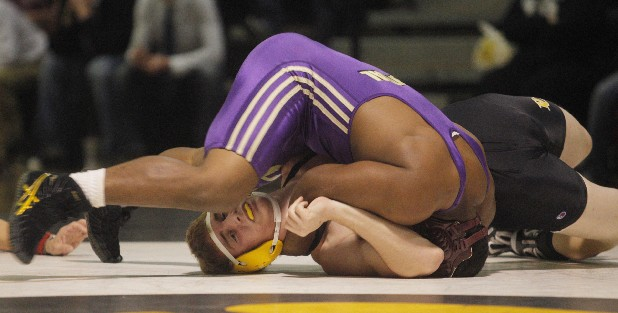 THE BURLY POUNDERS--Central High School's wrestling team begins the season with hopes of doing better than last year.