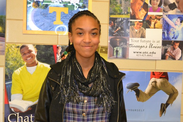 HAPPY AND HOPEFUL --Starlar Williams stands in the College Suite where her Chattanooga State acceptance letter is posted.