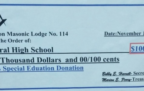 WHAT A DONATION -- The CDC program received a $1,000 gift from the Masons that is displayed at Central's front office.