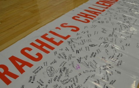 A COMMITMENT TO KEEP -- Upon leaving the assembly, students signed this banner, signifying that they accepted Rachel's Challenge.