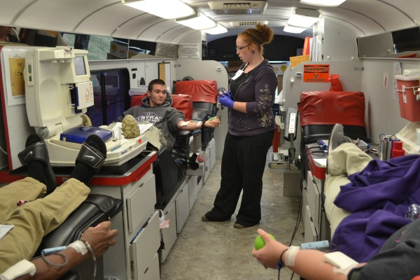 WE BLEED GOLD AND PURPLE -- Freshman Brandon Huyler and other students donate blood and save lives.