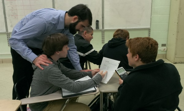 NEW ALGEBRA TEACHER -- Mr. Steward helps his students (from left to right) Hayden Gracy, Dakota Gable, Davey Vagts, and Andrew Bingham with their Algebra I homework.