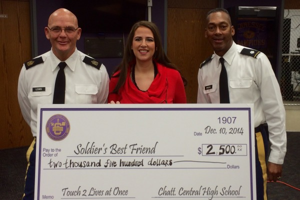 A CHECK LARGER THAN LIFE -- Ms. Thomas presented this check to her psychology students with (from left to right) Sergeant Major David Lewis and Lieutenant Colonel Bill Brooks.