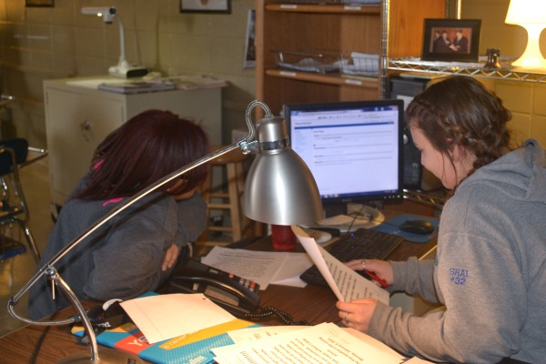 STAFF MEMBERS ON DECK -- Bria Battle, left, and Shai Markum, right,  work on more upcoming changes for the 2015-2015 yearbook.
