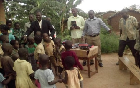 DISTRIBUTING HOPE -- Children in the Nakivale Refugee Camp eagerly await receiving a Bible.