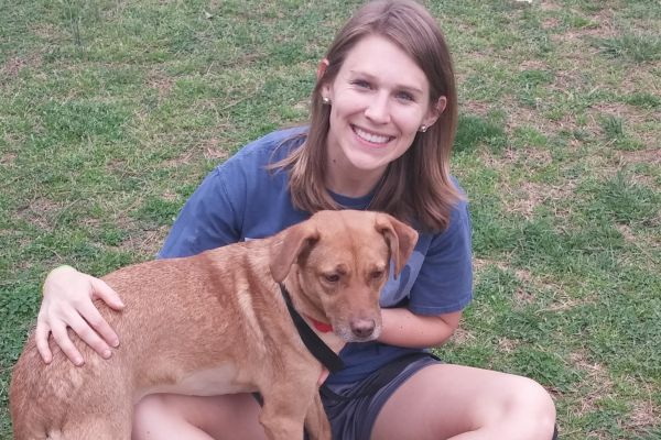 MARCHING THROUGH MARCH -- Ms. Katy Burnette and her new friend, Dude, like to play fetch and run in the rain.
