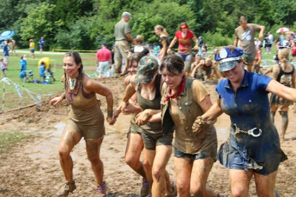 MUD RUN -- Mrs. White (far left) trucks through the muck-covered obstacle courses of the Mud Run with her friends.