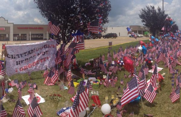 CHATTANOOGA MEMORIAL ON LEE HIGHWAY HONORS FALLEN SERVICEMEN -- Thousands of flags, banners, and flowers sit in front of the Armed Forces Career at a town-made memorial for the five fallen servicemen.