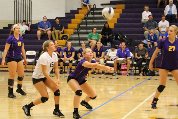 EYES ON THE BALL -- Central's Brooke Parrott (right) goes for a dig while temmate Sam Scott (left) waits nearby.