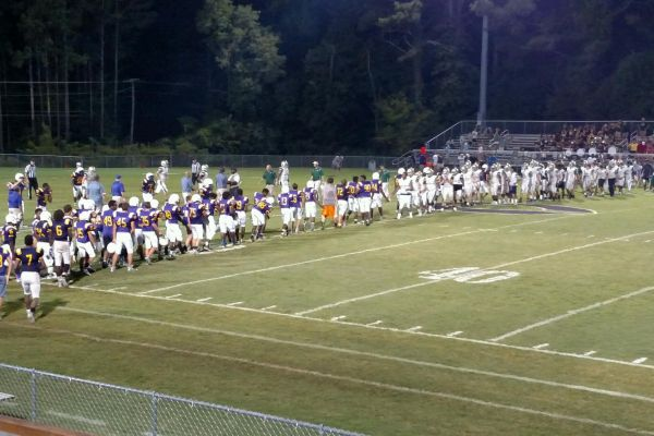 CENTRAL AND NOTRE DAME SHAKE HANDS AFTER A TOUGH GAME -- The teams shake hands after a long night on the field.