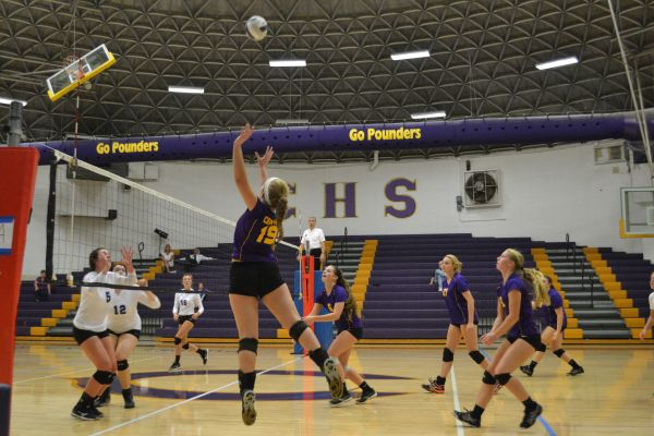 CENTRAL LADY POUNDERS FIGHT FOR VICTORY AT THURSDAY VOLLEYBALL GAME -- Central's girls' volleyball team battles for a win at volleyball game versus the East Hamilton Hurricanes.