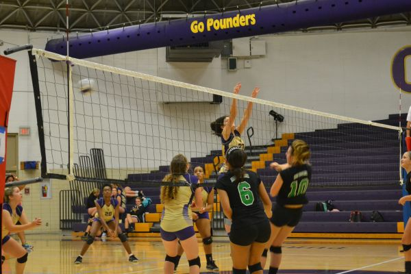 POUNDING THE HURRICANES -- East Hamilton was no match for Central in last week's volleyball game.