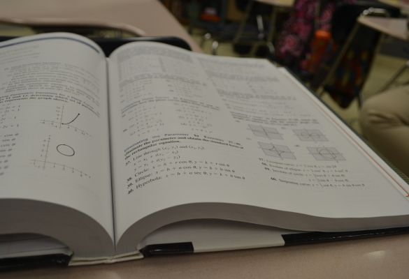 NEW MATH BOOKS MAKE STUDENTS THINK -- Central High's new math curriculum promotes the use of brain power in school.