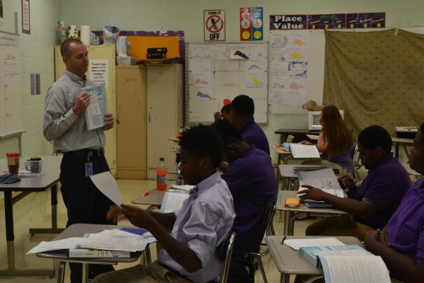 HARD AT WORK -- Mr. Mullins is committed to helping his students learn math.