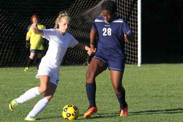 HUSTLING AND STEALING -- Central's Celisia Snakenberg, forward, shows her aggression towards her opponent.