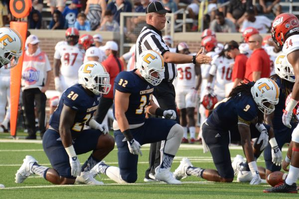 TIMOSHCHUK PREPARES FOR THE PLAY -- (Left to right) Dale Warren, Nikolay Timoshchuk, and Alphonso Stewart are getting into their stances at the Jacksonville State University earlier this season.