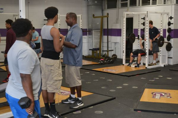 STUDENT ATHLETES PUT THE WEIGHT ROOM TO GOOD USE -- Though not totally ideal, CHS athletes use the weight room to improve during the off-seasons of their sports.