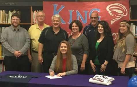 SIGNING PARTY -- CHS senior Rebecca Hill (seated) is so excited after getting signed to King University for volleyball.