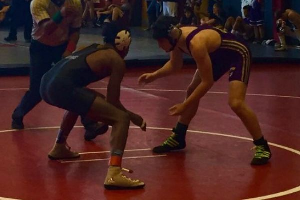 CHS WRESTLING IS GETTING OFF TO A GREAT START -- Isaac Coffman wrestles at  his first match of the seaason at Tulahoma, pushing hard for a pin.